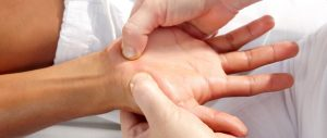 Chinese massage therapy treatment on the hand at Southpoint Health Clinic